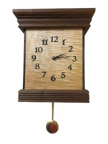This is  a walnut and curly maple chime clock