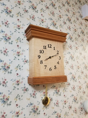 This is a West Minster chime Cherry and curly maple wood clock