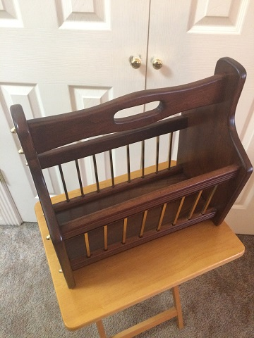 This is a Cherry and brass magazine rack